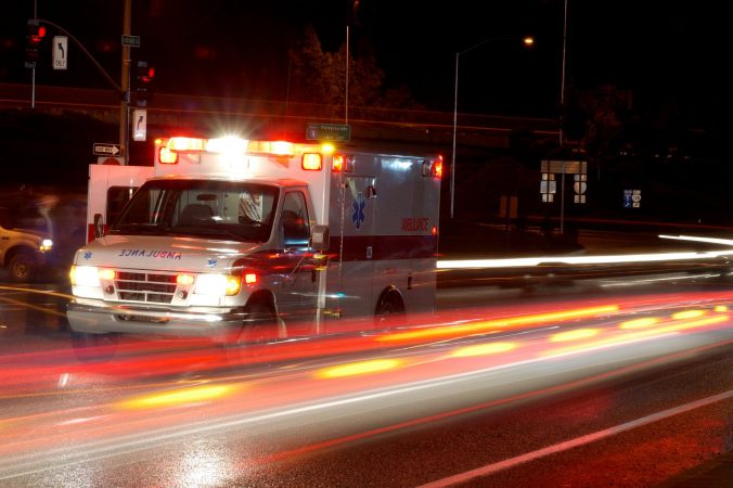 Ambulance and emergency equipment at a motor vehicle accident at night